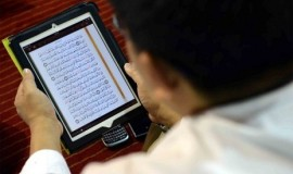 a-man-reads-quran-from-his-gadget-during-itikaf-_130802202535-820